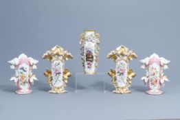 Two pairs of gilt and polychrome Paris porcelain vases and a 'chinoiserie' vase, 19th C.