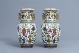 A pair of Chinese cloisonne vases with antiquities design, ca. 1900