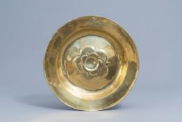 A large German brass alms dish with floral design, possibly 17th C.