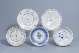 Five polychrome Brussels faience plates with floral design, 18th/19th C.