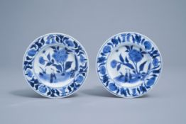 A pair of Chinese blue and white saucers with a boy in a landscape, Transitional period, 17th C.