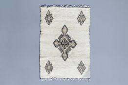 An Algerian woolen berber carpet with Crux, El-Oued, 20th C.