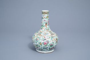 A Chinese Canton famille rose bottle vase with floral design, 19th C.