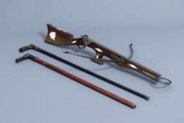 A French Druell(e) crossbow, Douai, and two walking sticks, which can be used as a pistle, 19th/20th