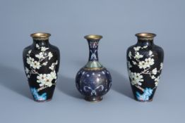 A pair of Chinese cloisonne vases with floral design and a bottle vase, 19/20th C.