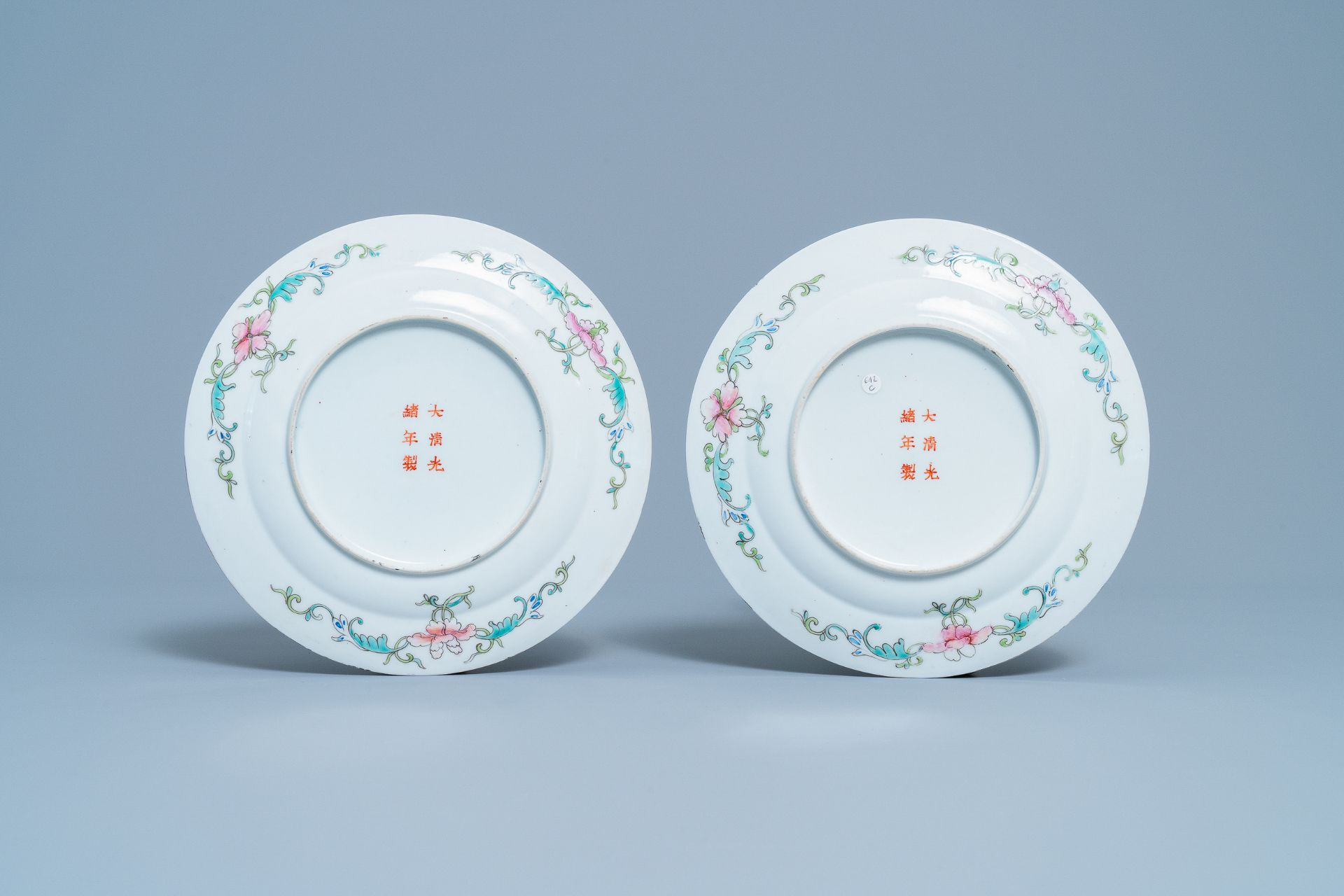 A pair of Chinese famille rose 'millefleurs' plates and a blue ground plate, 19th/20th C. - Image 3 of 5