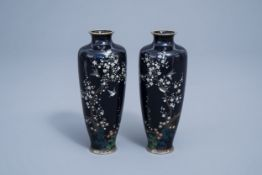 A pair of fine Japanese cloisonne vases with birds among blossoming branches, Meiji, 19th C.