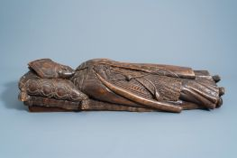 A French or Flemish carved wooden figure of a bishop on his deathbed, most probably Saint Bavo of Gh