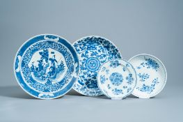 Four various Chinese blue and white chargers and plates with floral design and figures in a landscap