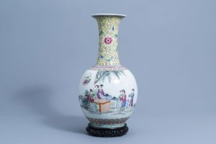 A large Chinese bottle shaped famille rose vase with ladies on a terrace, Qianlong mark, 20th C.