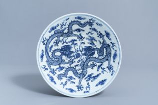 A Chinese blue and white 'dragons chasing the pearl' charger, 19th C.