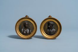 A pair of bronze Empire alto relievo plaques depicting the profile portraits of Napoleon and his wif