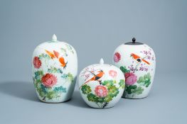 Three Chinese qianjiang cai jars and covers with a bird among blossoming branches, 19th/20th C.