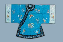 A Chinese blue ground embroidered silk women's robe with flowers and animals, 19th C.
