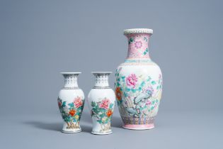 A pair of Chinese famille rose vases and a vase with floral design, 20th C.