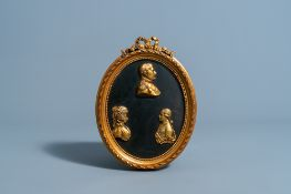 A French red copper plaque with three gilt profile busts of Napoleon Bonaparte, Louis XVI and Marie-