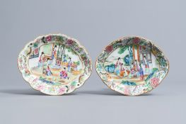 Two lobed Chinese Canton famille rose chargers with figures on a terrace, 19th C.