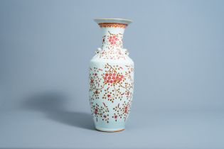A Chinese famille rose vase with floral design, 19th C.
