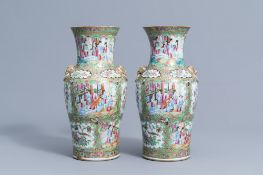 A pair of Chinese Canton famille rose baluster vases, 19th C.