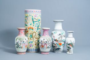 Four various Chinese famille rose vases and a 'dragons' umbrella stand, 20th C.