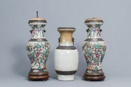 A pair of Chinese Nanking famille rose vases with warrior scenes & a Nanking celadon vase, 19th C.