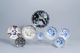 A varied collection of Chinese and Japanese blue, white, famille rose and Imari porcelain and a cloi
