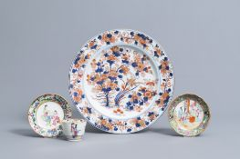 A Chinese Imari style charger with floral design and two famille rose saucers and a cup, 18th/19th C