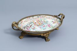 A Chinese Canton famille rose gilt bronze mounted charger, 19th C.