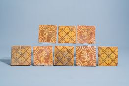 Eight Flemish slip decorated redware tiles with lions and a geometric design, 18th C.