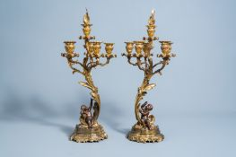 A pair of French gilt and patinated bronze Louis XV style five-light candelabra, 19th/20th C.