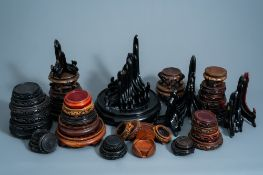 A collection of Chinese carved wooden stands and plate holders, 19th/20th C.