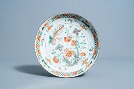 A Chinese famille verte charger with a phoenix among blossoming branches, Kangxi