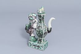 A Chinese verte biscuit 'Buddhist lion' ewer and cover, 19th C.