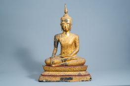 A large Thai gilt lacquered bronze figure of Buddha Maravijaya on a lotus throne, Rattanakosin, 18th