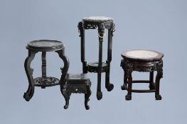 Four Chinese wood stands, one with a marble top, 20th C.