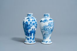 Two Chinese blue & white baluster vases with a mountain landscape, Kangxi mark, 19th C.