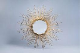 A large gilt metal sun mirror, 20th C.