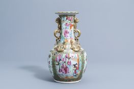 A Chinese Canton famille rose relief decorated 'dragons' bottle vase, 19th C.