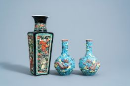 A pair of Chinese polychrome 'dragon' vases and a quadrangular 'Immortals' vase, 19th/20th C.