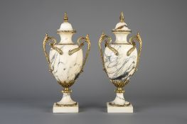 A pair of gilt bronze mounted Calacatta marble cassolettes, 19th/20th C.