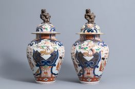 A pair of French Samson Imari style vases and covers with birds among flower branches and figures, 1