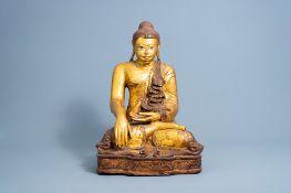 A tall inlaid gilt wood figure of a seated Buddha, Burma or Thailand, 19th/20th C.