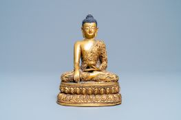 A Chinese turquoise inlaid gilt bronze figure of Buddha with an inscription, 20th C.