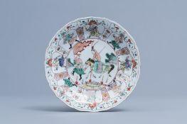 A Chinese lotus shaped famille verte 'Mu Guiying' dish, Kangxi