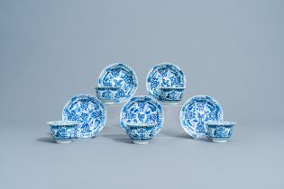 Five Chinese blue and white cups and saucers with landscapes and floral design, Kangxi mark, 19th C.