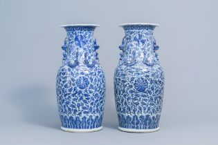 A pair of Chinese blue and white 'lotus scroll' vases with relief design, 19th C.