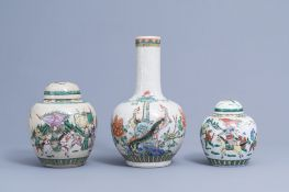 A Chinese bottle shaped Nanking crackle famille verte vase and two warrior jars, 19th/20th C.