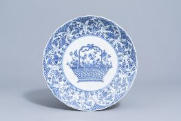 A lobed Chinese blue and white charger with a flower basket and floral design, Kangxi