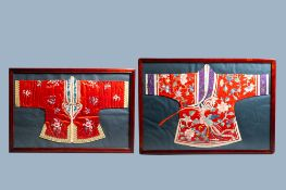 Two framed Chinese embroidered silk children's robes with floral design and animals, 19th/20th C.