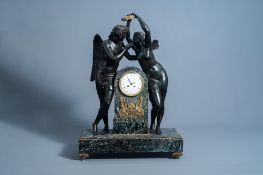 An impressive French patinated and gilt bronze mounted vert de mer marble Empire style mantel clock